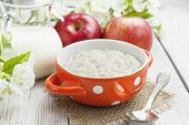 image of porridge  - Porridge oats milk and red apples on the table - JPG