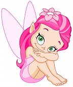 Smiling pink fairy sitting