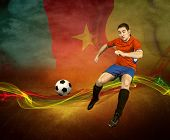 Abstract waves aroun soccer player on the national flag of Cameroon background