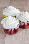stock photo of red velvet cake  - Red Velvet Cupcakes with a white cream cheese icing - JPG