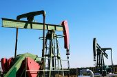 Two Oil Pumps Jacks Under Blue Sky