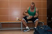 pic of tupperware  - Bodybuilder Eating Healthy Bodybuilding Diet Food Out Of Tupperware - JPG