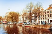 Amsterdam, Netherlands.-APRIL 23: Amsterdam canals on April 23, 2014. Beautiful view of Amsterdam ca