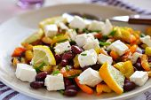 Bean salad with feta cheese, pepper, chives, and lemon