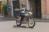 Biker Riding A Vintage Ducati Rt 450