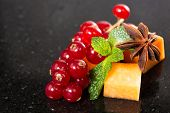 stock photo of fruit platter  - Assortment of delicious cheese and fruits on black - JPG