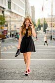 Teenager walking down street