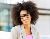 stock photo of afro hair  - Young businesswoman with afro hair  - JPG