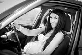 Beautiful Pregnant Woman Driving