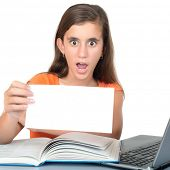 Teenage girl studying and holding a blank sign with space for text