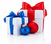 Two White Boxs Tied Red And Blue Ribbon Bow And Christmas Balls Isolated On White Background