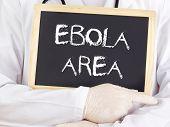Doctor Shows Information: Ebola Area