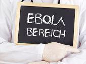 Doctor Shows Information: Ebola Area In German Language