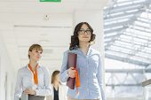 Businesswomen walking at office