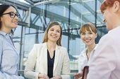 Happy businesswomen conversing in office