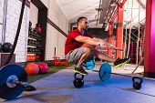 picture of pistols  - kettlebell man pistol squat balance at gym workout - JPG