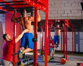 Toes to bar man pull-ups personal trainer 2 bars workout