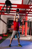 kettlebell swinging man weightlifting workout exercise at gym