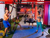 gym group weight lifting workout men and girls exercise