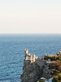 Aurora Cliff With Swallow's Nest Castle In Evening