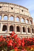 Monumental ancient Colosseum in Rome against blue sky, Italy
