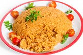 turkish bulgar pilaf made with bulgur, or burghul, wheat, onion, capsicum, and tomato, This is a staple of Turkish cuisine.