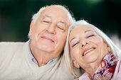 Loving senior couple relaxing with eyes closed at nursing home