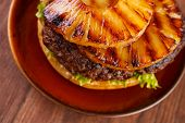 Burger with grilled pineapple