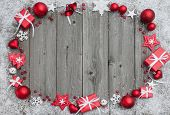 picture of gift wrapped  - Christmas background with festive decoration over wooden board - JPG