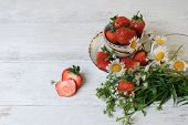 Cup With Strawberries And Wild Flowers