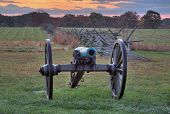 stock photo of artillery  - This is a piece of Union Artillery near a fence line at the Gettysburg National Military Park - JPG