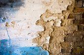 Damaged Plaster On The Brick Wall