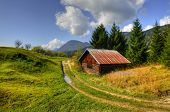pic of chalet  - Barn inset into the Alpine landscape in the middle of pastures - JPG
