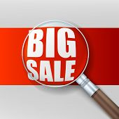 Big sale. Magnifying glass over red background.