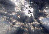 picture of jesus  - Dramatic clouds with sunbeams formed the face of Jesus Christ - JPG