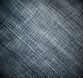 Perspective and closeup view to abstract space of empty light black natural clean denim texture for the traditional business background in cold bright colors with diagonal shift tilt line and stitches