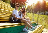 Summer Young Modern Stylish Couple In Sunglasses Rest In The City, Hipsters Teenagers In Urban Style