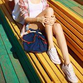 image of slender legs  - Trendy hipster resting in the city beautiful slender female legs in summer - JPG