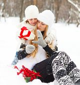 Happy Young Mother With Daughter With Present
