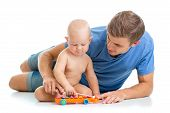 Father and baby boy have fun with musical toys