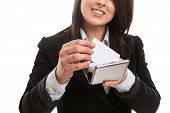 Young businesswoman putting business card in holder