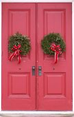red doors with wreath