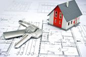 stock photo of ring  - model of a house and key ring on a blueprint - JPG