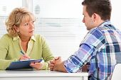 picture of counseling  - Doctor talking to her male patient at office - JPG