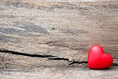 Red heart in crack of wooden plank. Symbol of love, Valentine's Day