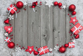 stock photo of christmas  - Christmas background with festive decoration over wooden board - JPG