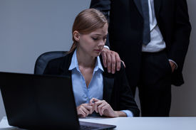 pic of inappropriate  - Horizontal view of Molesation by boss at workplace - JPG