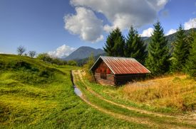 stock photo of barn house  - Barn inset into the Alpine landscape in the middle of pastures - JPG