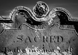 picture of empty tomb  - Closeup on Tomb stone with inscription Sacred In the Memory Of