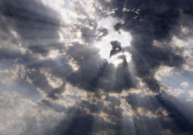 stock photo of doomsday  - Dramatic clouds with sunbeams formed the face of Jesus Christ - JPG